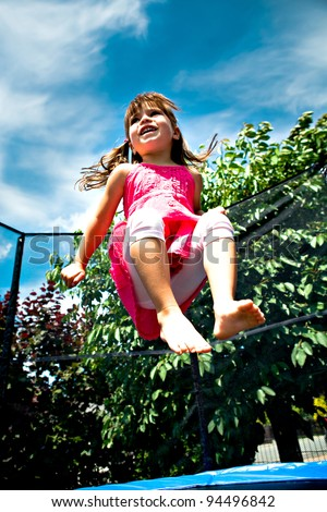 little girl jumping on the trampoline