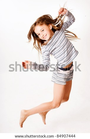 little girl jumps on a white background - stock photo