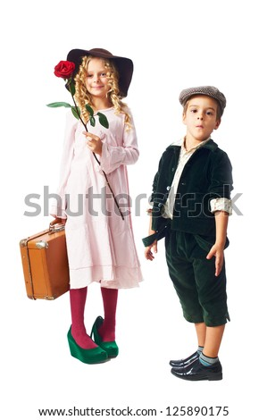 little girl keep red rose and vintage suitcase and cute little boy isolated on white background