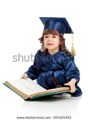 Little girl kid in academician clothes  with book - stock photo