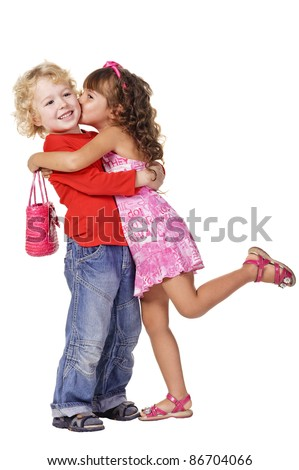little girl kissing beautiful little boy. Isolated over white - stock photo