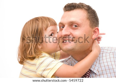 little girl kissing her father after he came back from work - stock photo