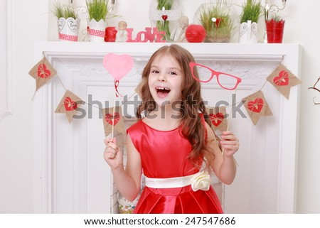 little girl laughing and hamming in a beautiful dress - stock photo