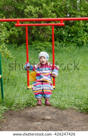 Little girl laughing in the Playground - stock photo