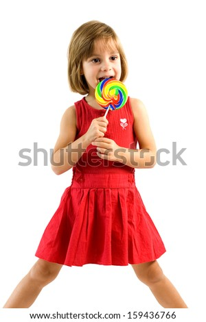 Little girl licking a colorfull lollpop - stock photo