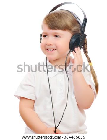 Little girl listen music by ear-phones - stock photo