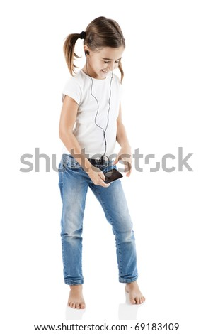 Little girl listen music with a MP3 player, isolated on white