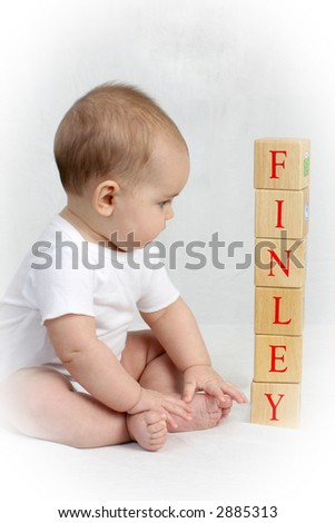 Little girl looking at blocks - stock photo