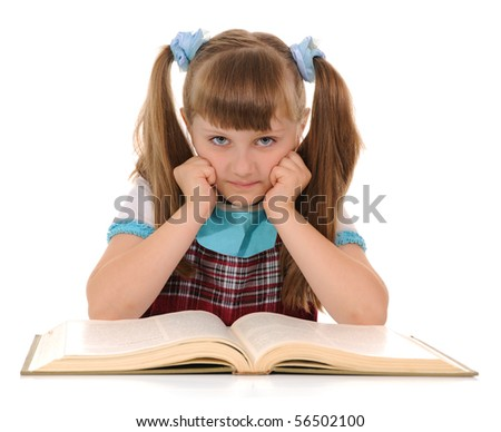 Little girl looking at camera with book