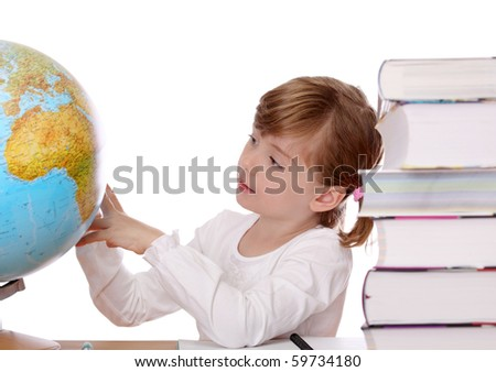 Little girl  looking at globe - stock photo