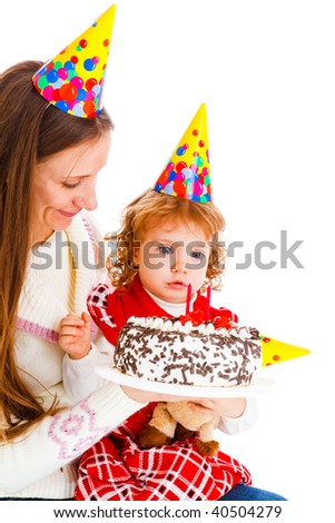 Little girl looking at her birthday cake
