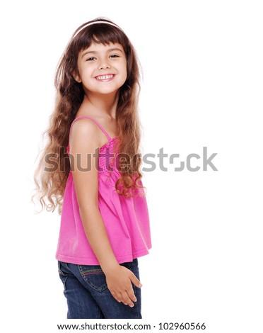 Little girl looking back over her shoulder - stock photo