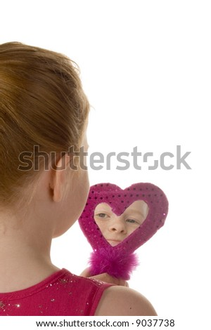 Little girl looking in a purple mirror - stock photo