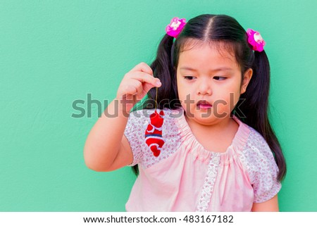 little girl looking Santa Claus toy