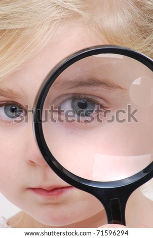 little girl looking through glass - stock photo