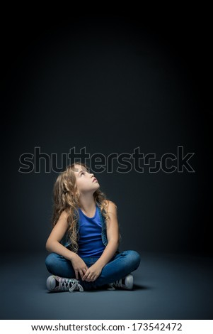 Little girl looking up in studio