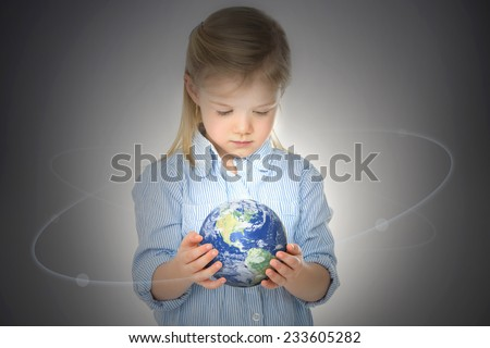 little girl makes magic with NASA map world - stock photo