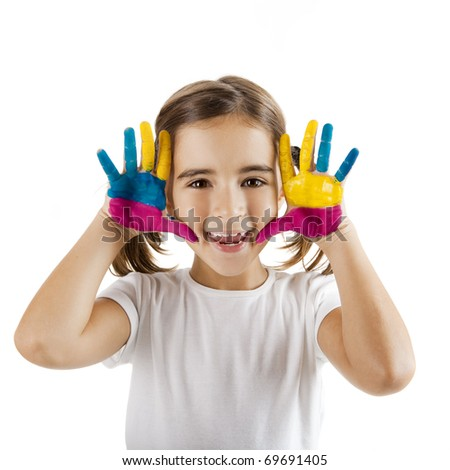Little girl making a funny face with both hands painted