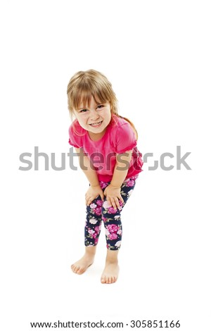 Little girl need a pee. Isolated on white background