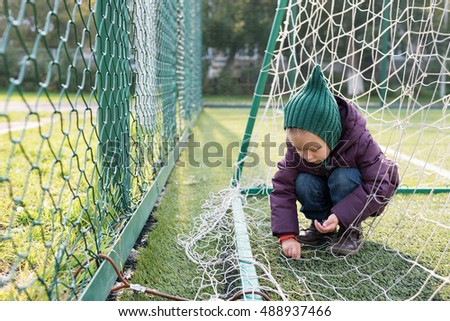 Little girl on a fooball pitch