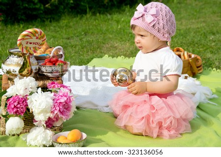 little girl on a picnic, in the street - stock photo