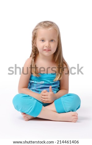Little girl on a white background posing for the camera