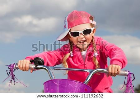 little girl on bicycle - stock photo