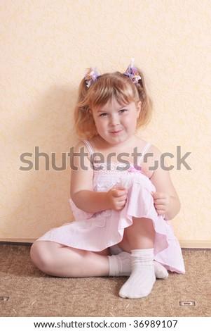 little girl on floor - stock photo