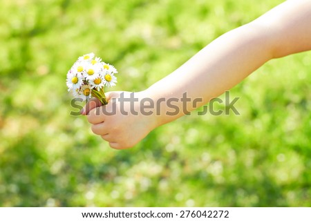 little girl on mothers day - with flowers - stock photo