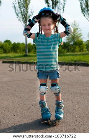 little girl on roller skates - stock photo