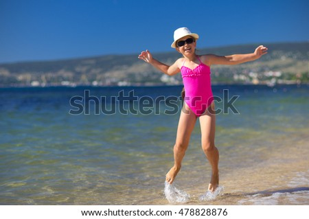 Little girl on sea coast