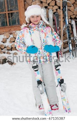Little girl on ski - stock photo