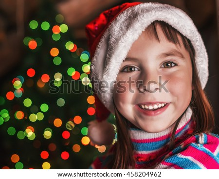 Little girl on the background of Christmas lights.