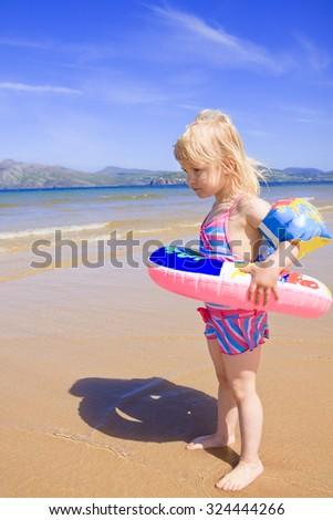 Little Girl on the beach. - stock photo