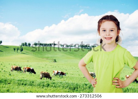 Little girl on the green meadow in countryside - stock photo