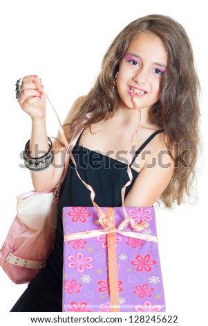 little girl opens the gift isolated on white - stock photo
