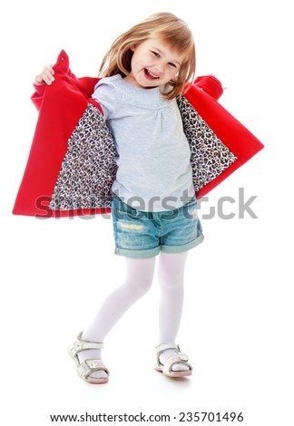 little girl opens the skirts of his coat. Happy childhood, fashion, autumnal mood concept. Isolated on white background - stock photo