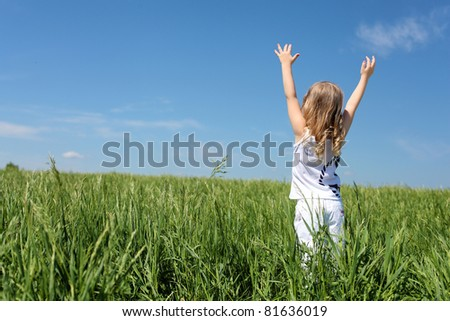little girl outdoors in sunny summer day - stock photo