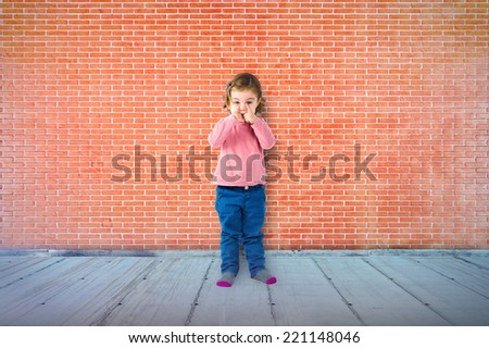 Little girl over textured background  - stock photo