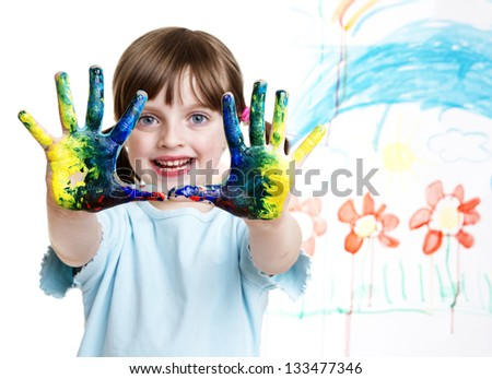 little girl painting her happy picture - stock photo