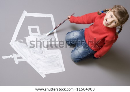 Little girl painting house - stock photo