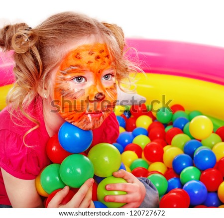 Little girl play colourful balls. Make up. - stock photo