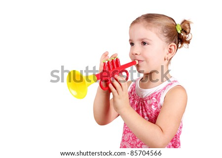 little girl play trumpet - stock photo