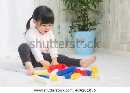 little girl playing - stock photo
