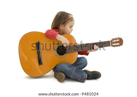little girl playing acoustic guitar isolated on white - stock photo