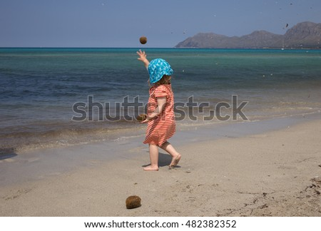 little girl playing at a beach