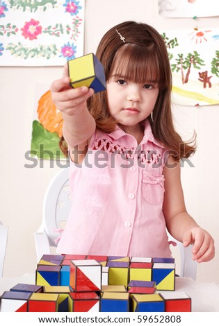 Little girl playing  block at home.