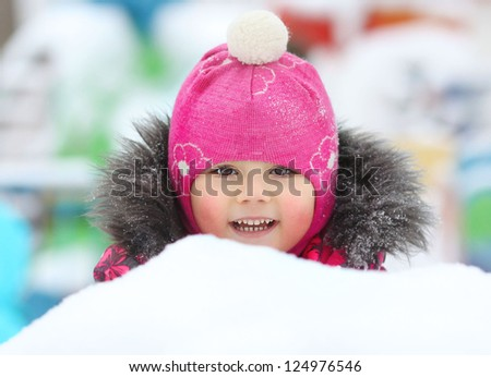 little girl playing in the snow, portrait - stock photo