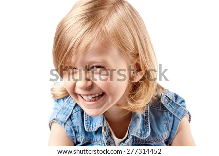 Little girl playing, laughing and having fun - stock photo
