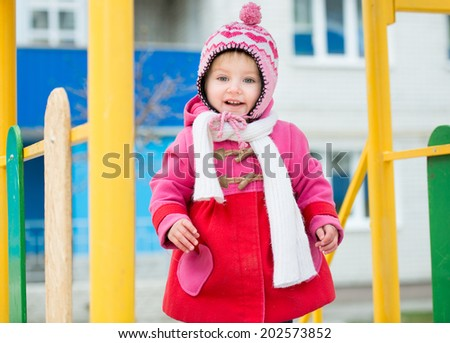 little girl playing on the playground, - stock photo